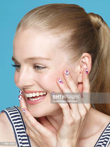 smiling young woman with custom nail tips