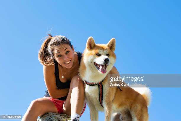 Smiling Young Woman With Dog
