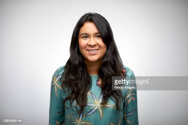 smiling young woman with long black hair - latijns amerikaanse en hispanic etniciteiten stockfoto's en -beelden