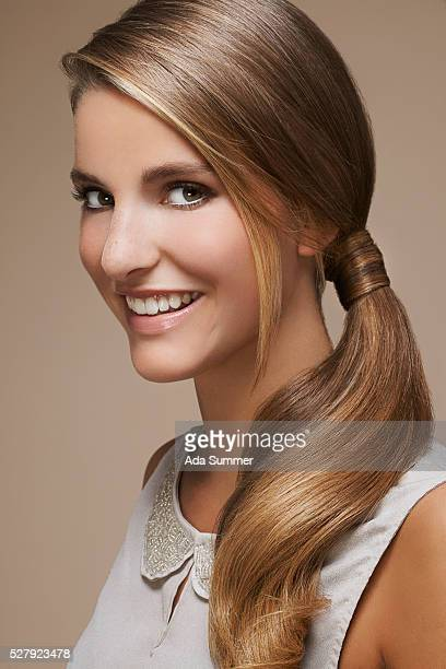 smiling young woman with ponytail