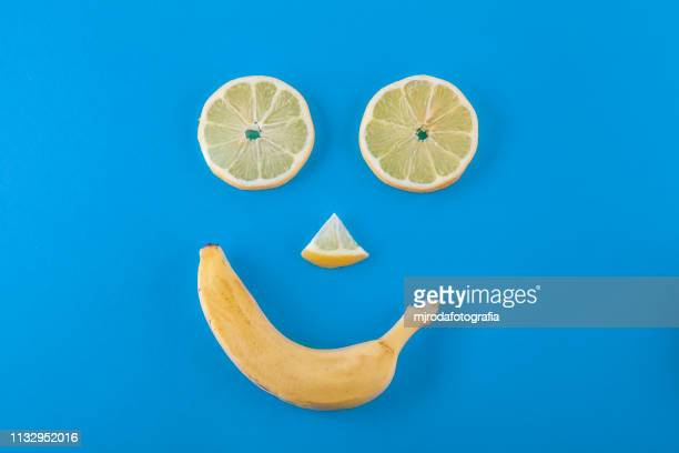 Smilling face made with lemons and banana fruits.