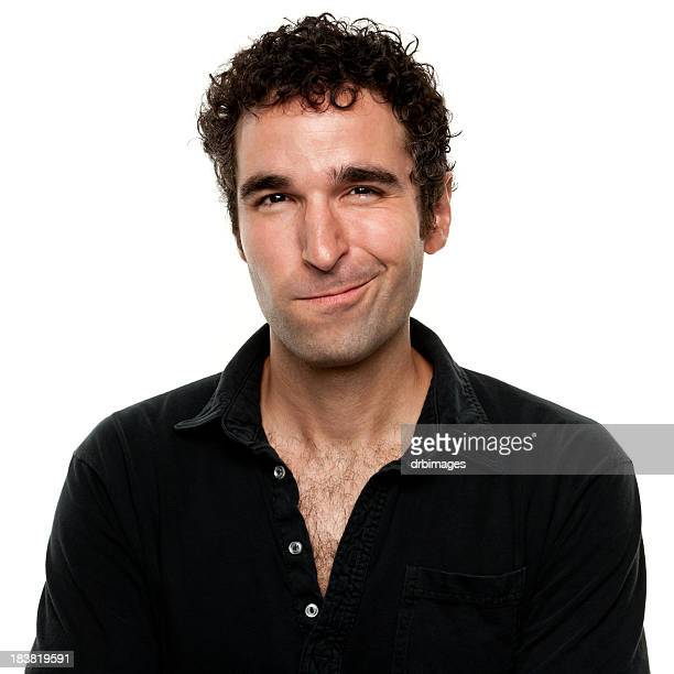 smirking man with shirt unbuttoned and curly hair - hairy chest stock photos and pictures