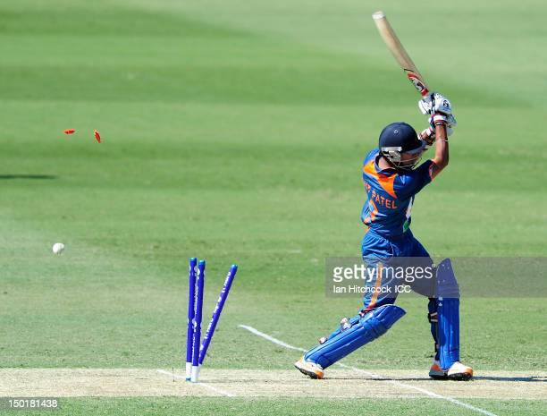 Smit Patel of India is bowled out during the ICC U19 Cricket World Cup 2012 match between the West Indies and India at Tony Ireland Stadium on August...