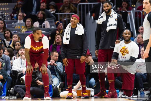Smith #5 Isaiah Thomas Tristan Thompson and Jae Crowder of the Cleveland Cavaliers watch from the sidelines during the final minute of the second...