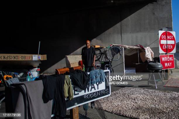 Smith 60 yearsold stands outside his tent under the bridge of the 110 Freeway at 39th Street during the novel Coronavirus COVID19 pandemic in Los...