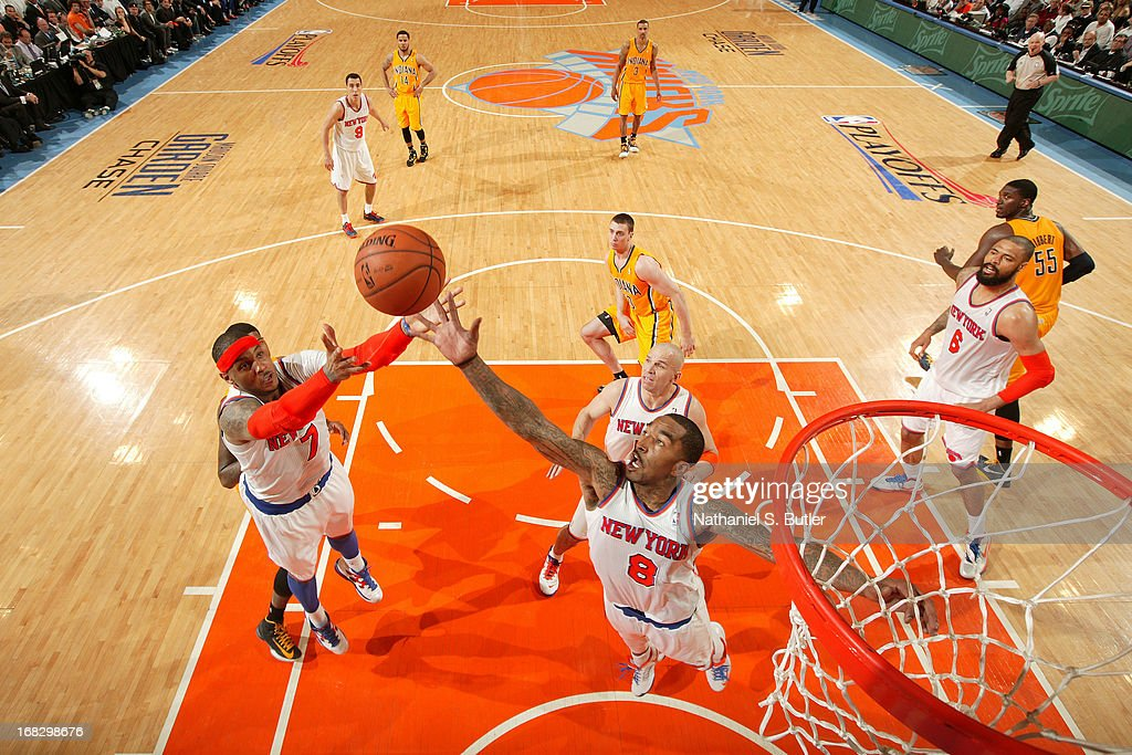 J.R. Smith #8 and Carmelo Anthony #7 of the New York Knicks grab the rebound against the Indiana Pacers in Game Two of the Eastern Conference Semifinals during the 2013 NBA Playoffs on May 7, 2013 at Madison Square Garden in New York City.