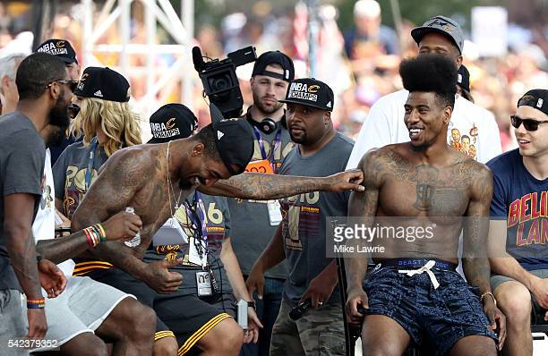 R Smith and Iman Shumpert of the Cleveland Cavaliers react onstage during the Cleveland Cavaliers 2016 NBA Championship victory parade and rally on...