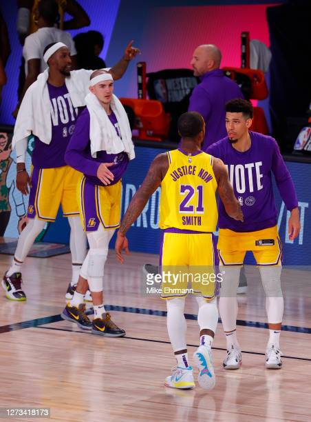 Smith celebrates with teammate Danny Green of the Los Angeles Lakers following a win against the Denver Nuggets in Game One of the Western Conference...