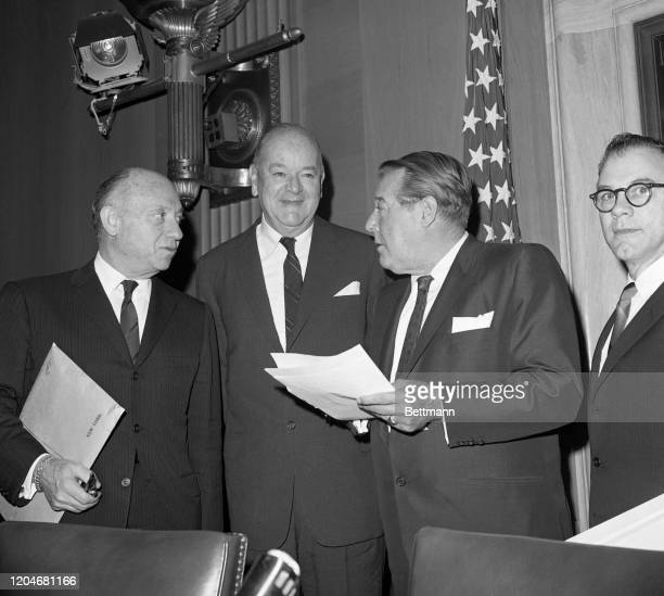 Smith, former head of American Airlines was accompanied by Senator Jacob Javits when he arrived at a hearing of the Senate Commerce Committee on his...