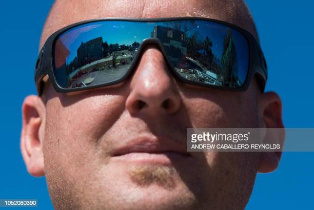 AJ Smith looks at destroyed beach houses in Port St Joe beach Florida on October 13 three days after hurricane Michael hit the area Since Hurricane...