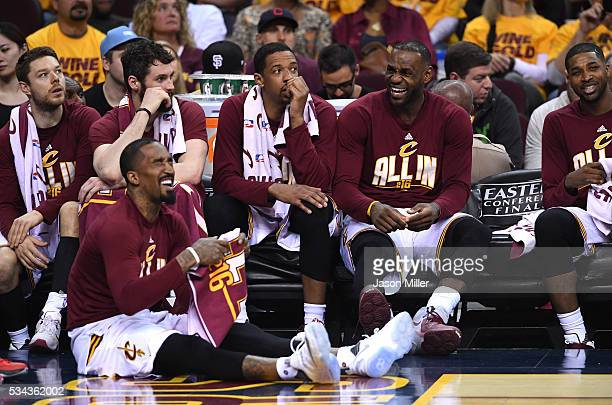 R Smith Matthew Dellavedova Kevin Love Channing Frye LeBron James and Tristan Thompson of the Cleveland Cavaliers look on from the bench late in the...