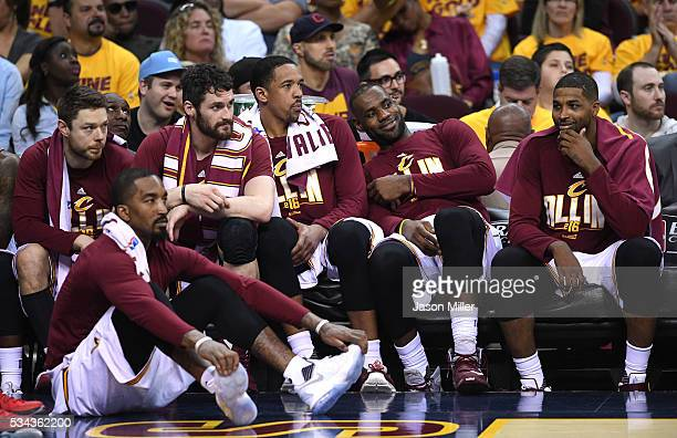 Smith, Matthew Dellavedova, Kevin Love, Channing Frye, LeBron James and Tristan Thompson of the Cleveland Cavaliers look on from the bench late in...