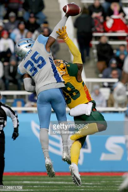 J Smith of Salt Lake Stallions defends a pass intended for Josh Huff of Arizona Hotshots during their Alliance of American Football game at Rice...