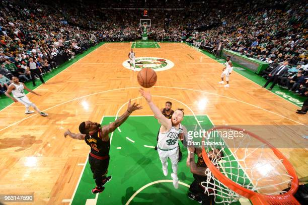 Smith of the Cleveland Cavaliers and Aron Baynes of the Boston Celtics reach for the ball during Game Seven of the Eastern Conference Finals of the...
