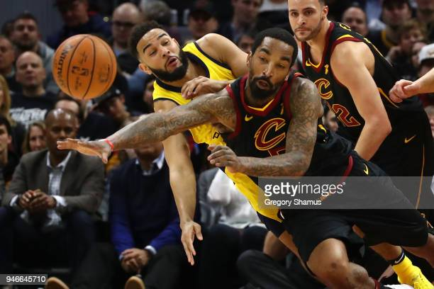 Smith of the Cleveland Cavaliers and Cory Joseph of the Indiana Pacers drive for a ball during the first half in Game One of the Eastern Conference...