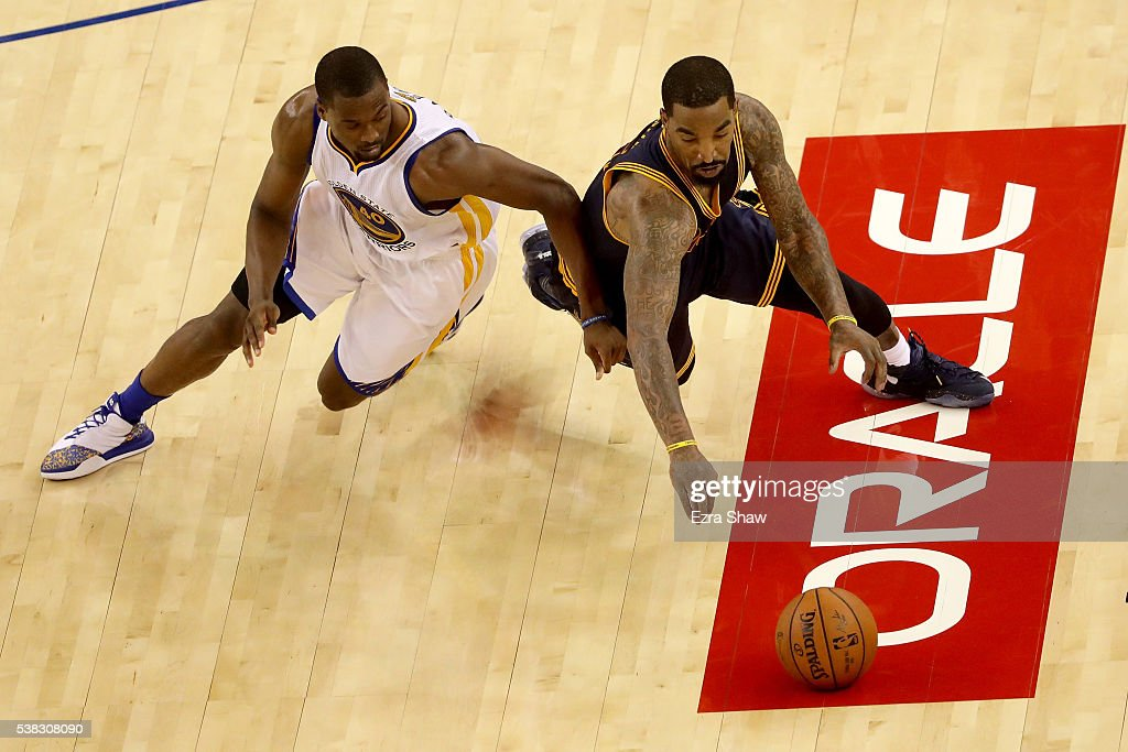 J.R. Smith #5 of the Cleveland Cavaliers and Harrison Barnes #40 of the Golden State Warriors dive for a loose ball during Game 2 of the 2016 NBA Finals at ORACLE Arena on June 5, 2016 in Oakland, California.