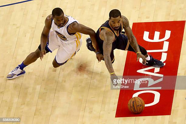 R Smith of the Cleveland Cavaliers and Harrison Barnes of the Golden State Warriors dive for a loose ball during Game 2 of the 2016 NBA Finals at...