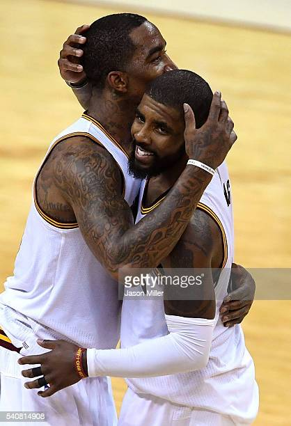 R Smith of the Cleveland Cavaliers and Kyrie Irving react during the first half in Game 6 of the 2016 NBA Finals against the Golden State Warriors at...