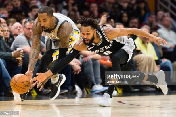 Smith of the Cleveland Cavaliers and Patty Mills of the San Antonio Spurs dive for a loose ball during the second half at Quicken Loans Arena on...