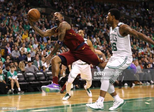 Smith of the Cleveland Cavaliers attempts a shot past Marcus Smart of the Boston Celtics during the second quarter in Game One of the Eastern...