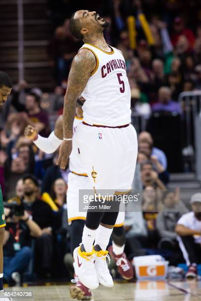 R Smith of the Cleveland Cavaliers celebrates after hitting a three point shot during the final minutes of the the second half against the Utah Jazz...