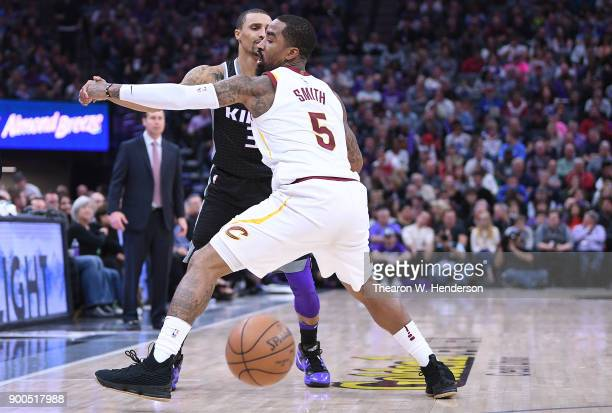 Smith of the Cleveland Cavaliers closely guards George Hill of the Sacramento Kings during their NBA basketball game at Golden 1 Center on December...