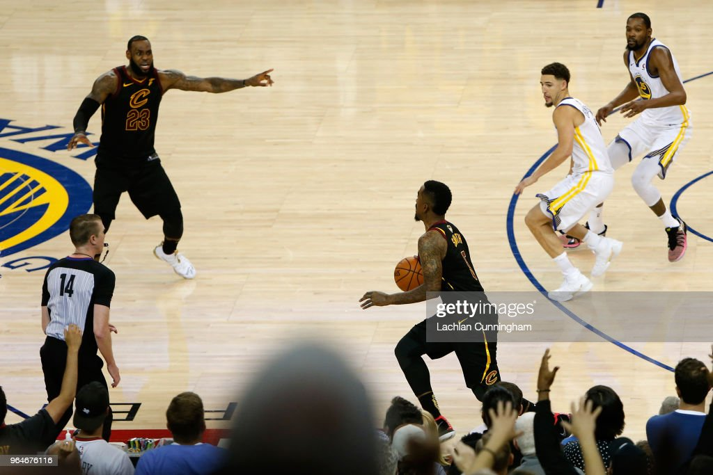 JR Smith #5 of the Cleveland Cavaliers dribbles in the closing seconds of regulation as LeBron James #23 attempts direct the offense against the Golden State Warriors in Game 1 of the 2018 NBA Finals at ORACLE Arena on May 31, 2018 in Oakland, California.