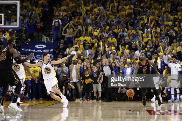 Smith of the Cleveland Cavaliers dribbles in the closing seconds of regulation as LeBron James attempts direct the offense against the Golden State...