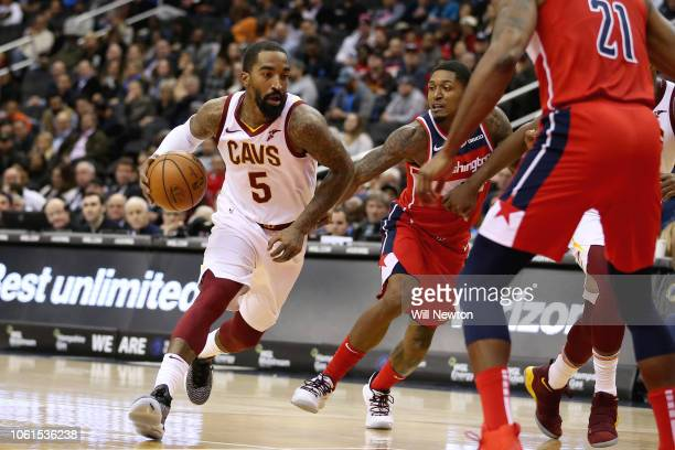 Smith of the Cleveland Cavaliers dribbles past Bradley Beal of the Washington Wizards during the first half at Capital One Arena on November 14 2018...