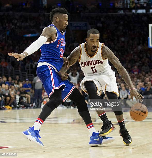 R Smith of the Cleveland Cavaliers dribbles the ball against Robert Covington of the Philadelphia 76ers in the fourth quarter at Wells Fargo Center...