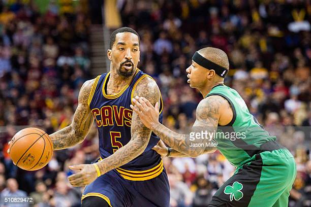 R Smith of the Cleveland Cavaliers drives around Isaiah Thomas of the Boston Celtics during the first half at Quicken Loans Arena on February 5 2016...