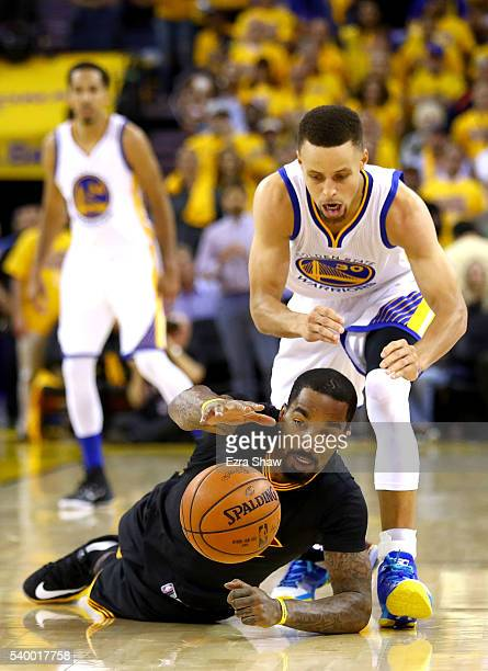 R Smith of the Cleveland Cavaliers fights for the ball against Stephen Curry of the Golden State Warriors during the third quarter in Game 5 of the...