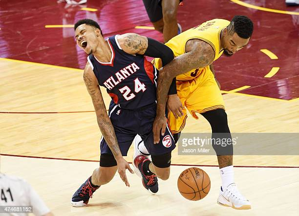 R Smith of the Cleveland Cavaliers fouls Kent Bazemore of the Atlanta Hawks in the third quarter during Game Three of the Eastern Conference Finals...