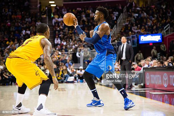 R Smith of the Cleveland Cavaliers guards Wesley Matthews of the Dallas Mavericks during the first half at Quicken Loans Arena on November 25 2016 in...