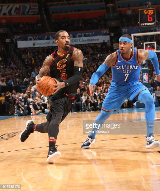 Smith of the Cleveland Cavaliers handles the ball against Carmelo Anthony of the Oklahoma City Thunder on February 13 2018 at Chesapeake Energy Arena...