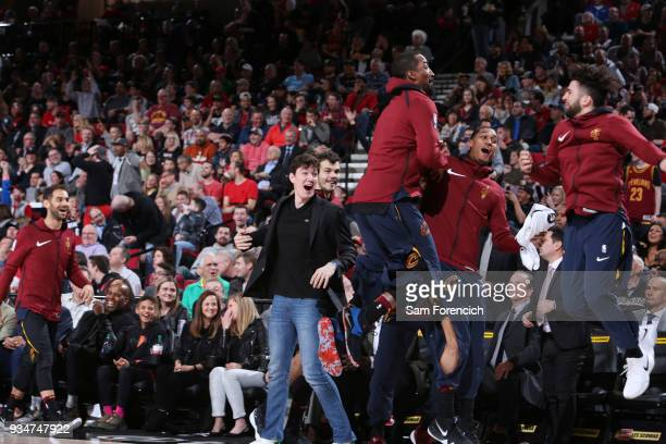Smith of the Cleveland Cavaliers Jordan Clarkson and London Perrantes of the Cleveland Cavaliers react to a play against the Portland Trail Blazers...