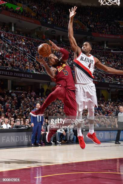 Smith of the Cleveland Cavaliers passes the ball against Maurice Harkless of the Portland Trail Blazers against the Portland Trail Blazers on January...