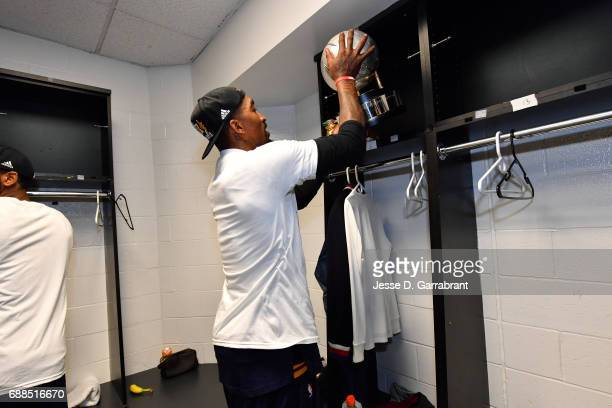 Smith of the Cleveland Cavaliers places the Eastern Conference trophy on the shelf after the game against the Boston Celtics during Game Five of the...