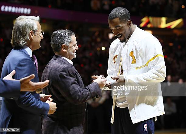 R Smith of the Cleveland Cavaliers receives his championship ring from owner Dan Gilbert before the game against the New York Knicks at Quicken Loans...