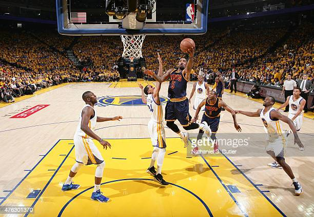R Smith of the Cleveland Cavaliers shoots over Shaun Livingston of the Golden State Warriors during Game Two of the 2015 NBA Finals on June 7 2015 at...