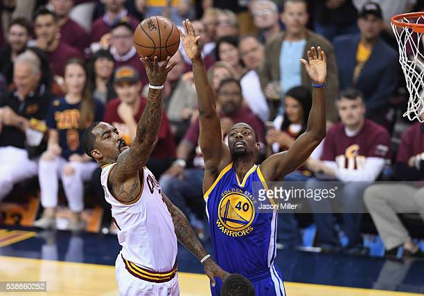 R Smith of the Cleveland Cavaliers shoots the ball against Harrison Barnes of the Golden State Warriors during the first half in Game 3 of the 2016...