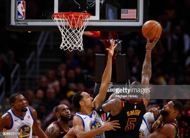 Smith of the Cleveland Cavaliers shoots the ball against Shaun Livingston of the Golden State Warriors at Quicken Loans Arena on January 15 2018 in...