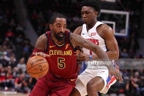 Smith of the Cleveland Cavaliers tries to drive around Stanley Johnson of the Detroit Pistons during the first half at Little Caesars Arena on...