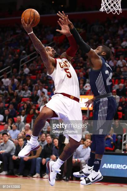 Smith of the Cleveland Cavaliers tries to get a shot off past Dwight Buycks of the Detroit Pistons during the first half at Little Caesars Arena on...