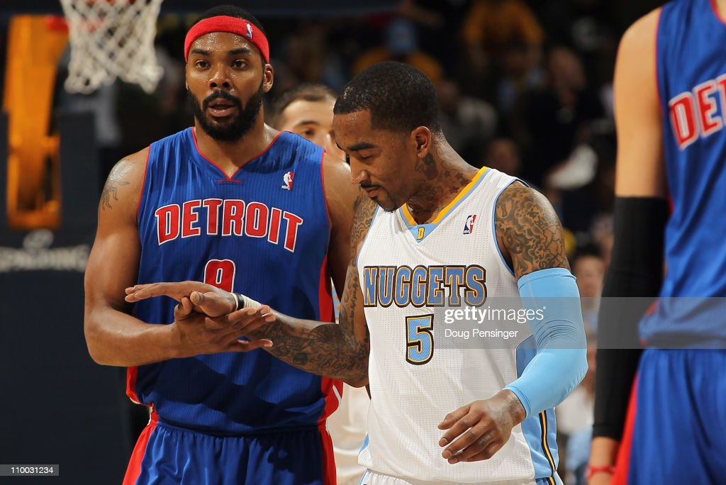 J.R. Smith #5 of the Denver Nuggets and Chris Wilcox #9 of the Detroit Pistons meet at midcourt after the game at the Pepsi Center on March 12, 2011 in Denver, Colorado. The Nuggets defeated the Pistons 131-101.