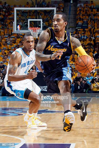 R Smith of the Denver Nuggets drives past Rasual Butler of the New Orleans Hornets in Game Three of the Western Conference Quarterfinals during the...