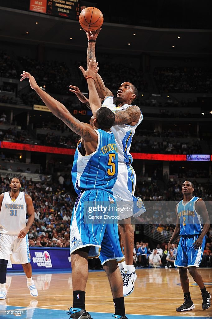J.R. Smith #5 of the Denver Nuggets lays up a shot over Marcus Thornton #5 of the New Orleans Hornets during the game on March 18, 2010 at the Pepsi Center in Denver, Colorado. The Nuggets won 93-80.