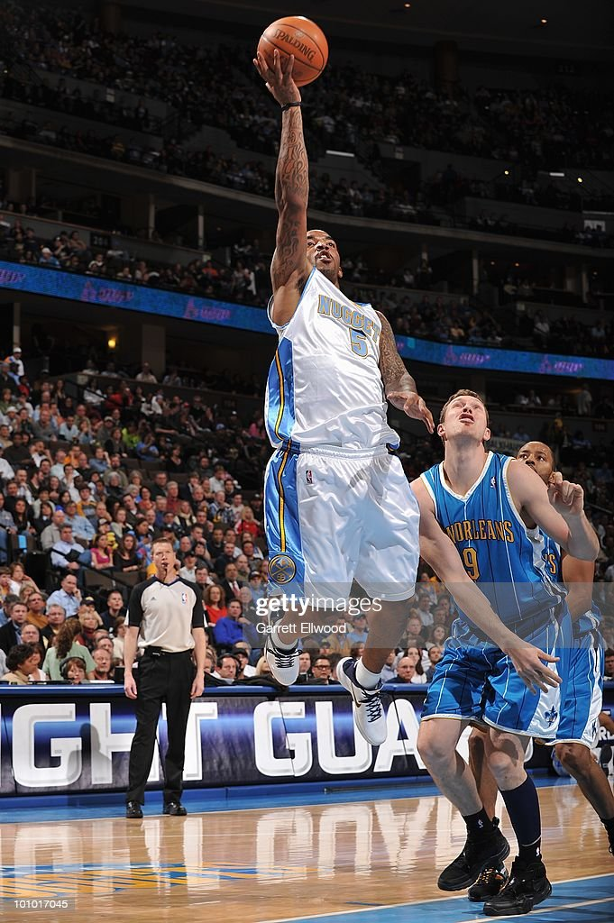 J.R. Smith #5 of the Denver Nuggets takes the ball to the basket past Darius Songaila #9 of the New Orleans Hornets during the game on March 18, 2010 at the Pepsi Center in Denver, Colorado. The Nuggets won 93-80.