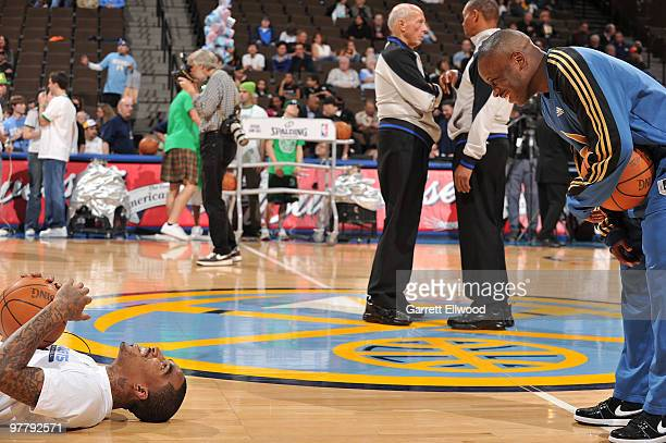R Smith of the Denver Nuggets talks with Earl Bonkins of the Washington Wizards on March 16 2010 at the Pepsi Center in Denver Colorado NOTE TO USER...