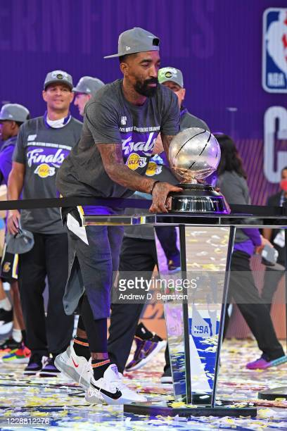 Smith of the Los Angeles Lakers grabs the Western Conference Championship Trophy after Game Five of the Western Conference Finals against the Denver...